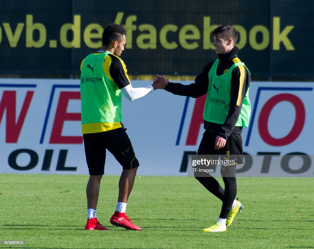 Pierre-Emerick Aubameyang of Dortmund shakes hands with Julian Weigl of Dortmund during a training session at BVB trainings center on November 5, 2017 in Dortmund.