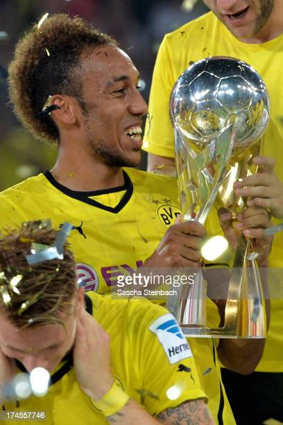 PierreEmerick Aubameyang of Dortmund shows the trophy after winning the DFL Supercup match between Borussia Dortmund and FC Bayern Muenchen at Signal...