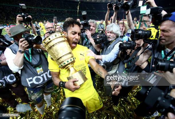 PierreEmerick Aubameyang of Dortmund takes a selfie while celebrating with the trophy after winning the DFB Cup final match between Eintracht...