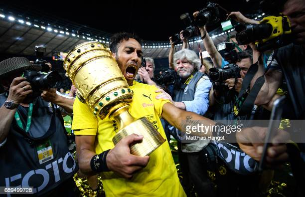 PierreEmerick Aubameyang of Dortmund takes a selfie with the trophy after winning the DFB Cup Final 2017 between Eintracht Frankfurt and Borussia...