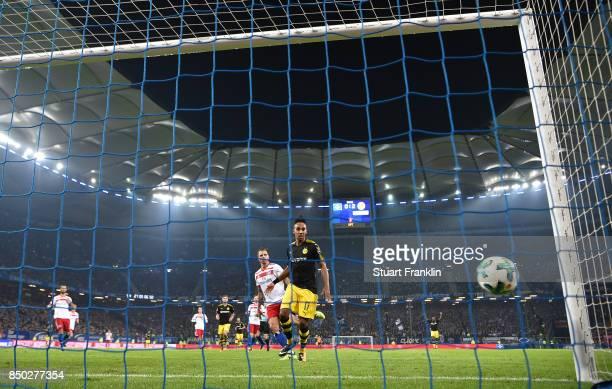 PierreEmerick Aubameyang of Dortmund watches the ball as Christian Pulisic of Dortmund scores Dortmunds third goal to make it 30 during the...