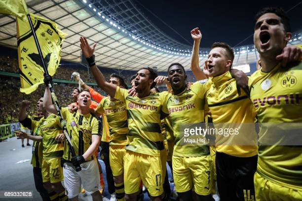 PierreEmerick Aubameyang Ousmane Dembele and Marco Reus of Dortmund celebrate with a team after winning the DFB Cup final match between Eintracht...