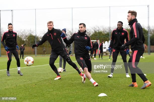 PierreEmerick Aubameyang Per Mertesacker Henrikh Mkhitaryan Danny Welbeck and Calum Chambers of Arsenal during the Arsenal training session at London...
