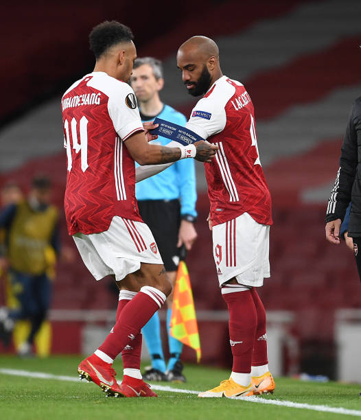 Pierre-Emerick Aubameyang puts the captains armband on Alex Lacazette after his substitution during the UEFA Europa League Semi-final Second Leg...