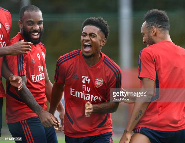 Pierre-Emerick Aubameyang, Reiss Nelson and Pierre-Emerick Aubameyang of Arsenal during the Arsenal Training Session at London Colney on July 26,...
