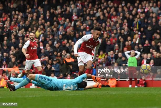 PierreEmerick Aubameyang scores Arsenal's 2nd goal past Orestis Karnezis of Watford during the Premier League match between Arsenal and Watford at...