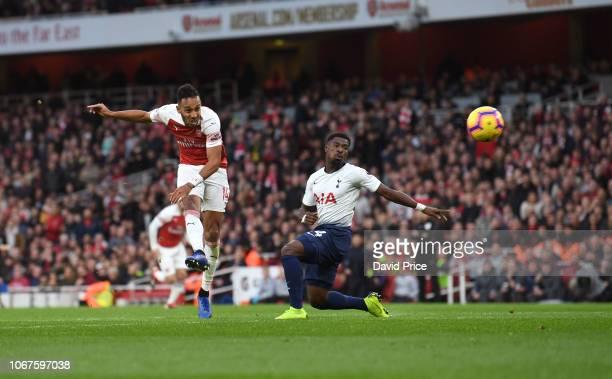 PierreEmerick Aubameyang scores Arsenal's 2nd goal under pressure from Serge Aurier of Tottenham during the Premier League match between Arsenal FC...