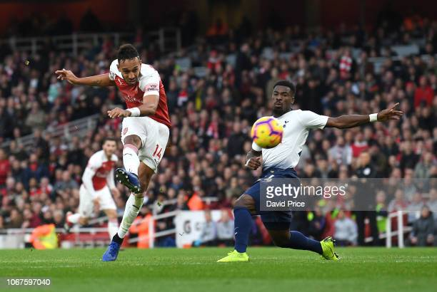 PierreEmerick Aubameyang scores Arsenal's 2nd goal under pressure from Serge Aurier of Tottenham during the Premier League match between Arsenal FC...