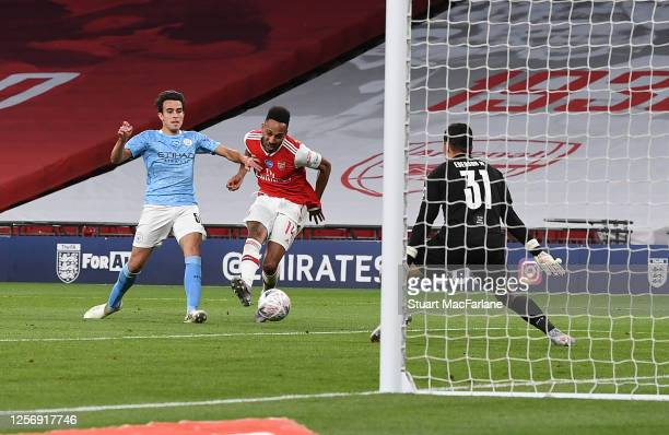 Pierre-Emerick Aubameyang scores the 2nd Arsenal goal during the FA Cup Semi Final match between Arsenal and Manchester City at Wembley Stadium on...