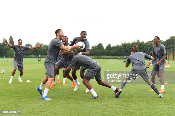 PierreEmerick Aubameyang Sead Kolasinac Chuba Akpom Alex Lacazette Hector Bellerin and Joe Willock of Arsenal during a training session at London...
