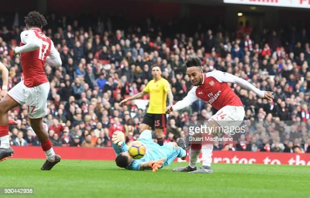 PierreEmerick Aubameyang shoots past Watford goalkeeper Orestis Karnezis to score the 2nd Arsenal goal during the Premier League match between...