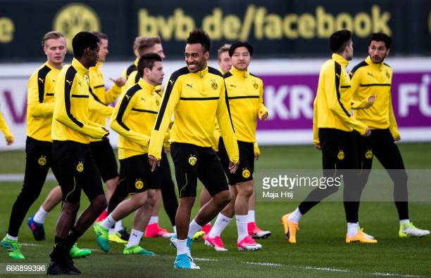 PierreEmerick Aubameyang smiles during a training with a team prior the UEFA Champions League Quarter Final First Leg match between Borussia Dortmund...