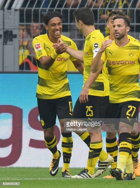 PierreEmerick Aubameyang Sokratis Papastathopoulos and Gonzalo Castro of Borussia Dortmund celebrate after scoring the 10 during the game between...