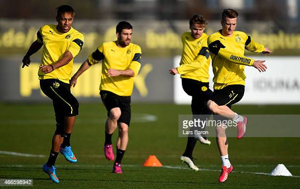 PierreEmerick Aubameyang Sokratis Papastathopoulos Marcel Schmelzer and Marco Reus warm up during a Borussia Dortmund training session at Signal...
