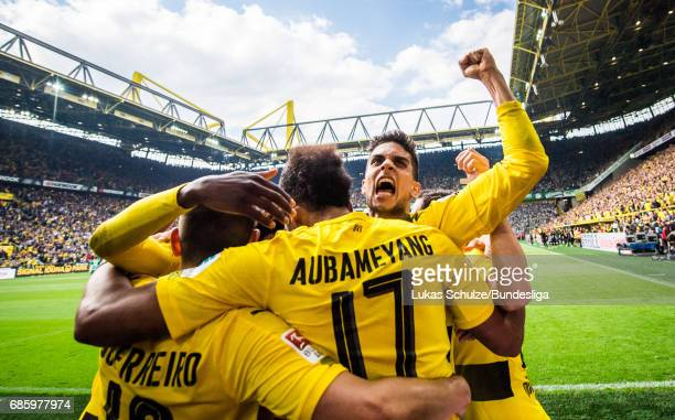 PierreEmerick Aubameyang who scores his teams fourth goal celebrates with Marc Bartra and team mates during the Bundesliga match between Borussia...