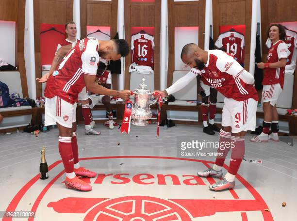 Pierre-Emerick Aubmeyang and Alex Lacazette celebrate after the FA Cup Final match between Arsenal and Chelsea at Wembley Stadium on August 01, 2020...