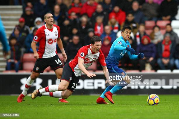 PierreEmile Højbjerg of Southampton FC goes down after a tackle from Alexis Sanchez during the Premier League match between Southampton and Arsenal...