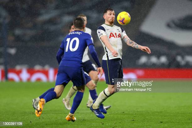 Pierre-Emile Hoejbjerg of Tottenham Hotspur controls the ball under pressure from Christian Pulisic of Chelsea during the Premier League match...