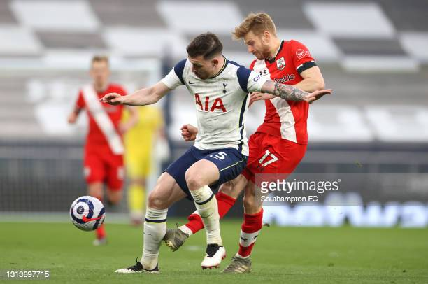 Pierre-Emile Hoejbjerg of Tottenham Hotspur is challenged by Stuart Armstrong of Southampton during the Premier League match between Tottenham...