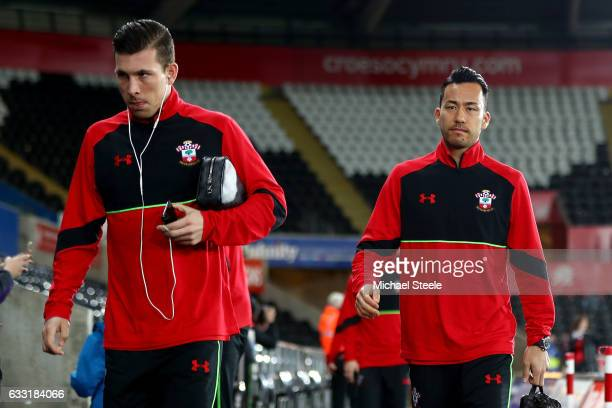 PierreEmile Hojbjerg and Maya Yoshida of Southampton arrive at the stadium prior to the Premier League match between Swansea City and Southampton at...
