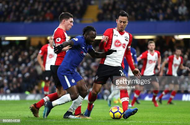 PierreEmile Hojbjerg and Maya Yoshida of Southampton battle for posession with N'Golo Kante of Chelsea during the Premier League match between...