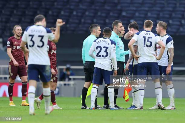 Pierre-Emile Hojbjerg, Eric Dier, Toby Alderweireld and Steven Bergwijn of Tottenham Hotspur talk with Referee, David Coote after the Premier League...