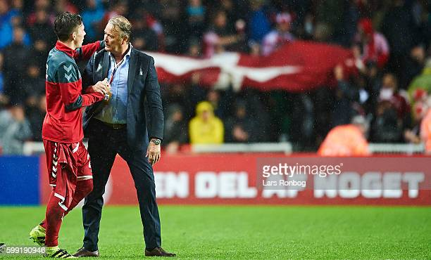 PierreEmile Hojbjerg of Denmark and Age Hareide head coach of Denmark celebrate after the FIFA World Cup 2018 european qualifier match between...