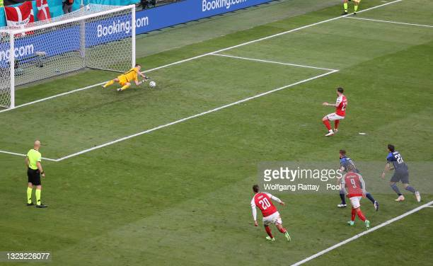 Pierre-Emile Hojbjerg of Denmark has a penalty saved by Lukas Hradecky of Finland during the UEFA Euro 2020 Championship Group B match between...