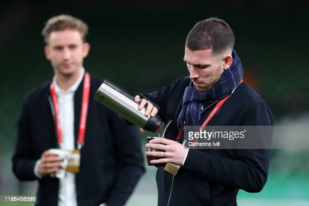 PierreEmile Hojbjerg of Denmark pours himself a drink from his flask as he inspects the pitch ahead of the UEFA Euro 2020 qualifier between Republic...
