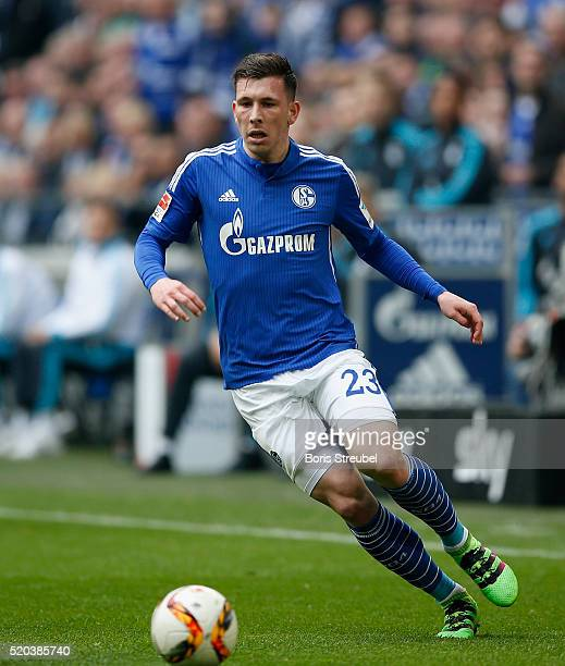 PierreEmile Hojbjerg of FC Schalke 04 runs with the ball during the Bundesliga match between FC Schalke 04 and Borussia Dortmund at VeltinsArena on...