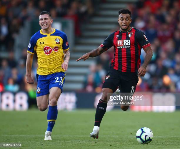 PierreEmile Hojbjerg of Southampton and Charlie Daniels of AFC Bournemouth in action during the Premier League match between AFC Bournemouth and...