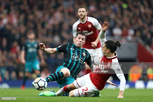 PierreEmile Hojbjerg of Southampton and Hector Bellerin of Arsenal in action during the Premier League match between Arsenal and Southampton at...