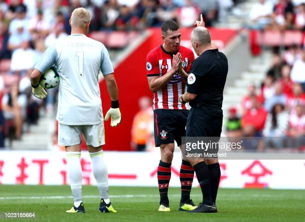 PierreEmile Hojbjerg of Southampton appeals as he is shown a red card by referee Jonathan Moss during the Premier League match between Southampton FC...
