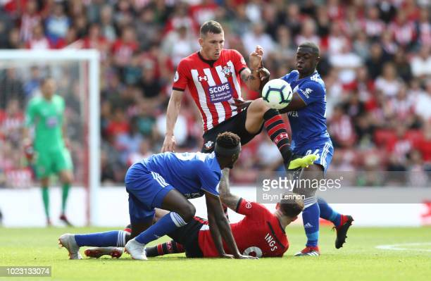 PierreEmile Hojbjerg of Southampton battles for possession with Nampalys Mendy of Leicester City during the Premier League match between Southampton...