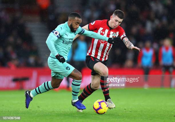 PierreEmile Hojbjerg of Southampton battles for possession with Alexandre Lacazette of Arsenal during the Premier League match between Southampton FC...