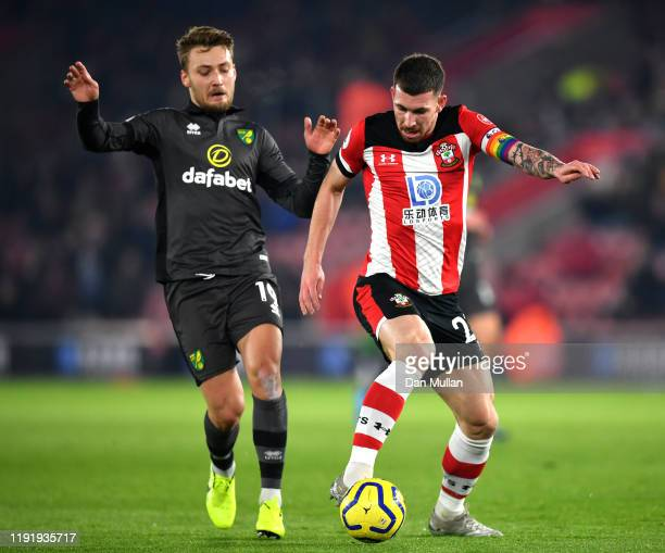 Pierre-Emile Hojbjerg of Southampton battles for possession with Tom Trybull of Norwich City during the Premier League match between Southampton FC...