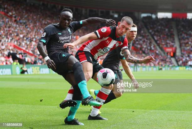 PierreEmile Hojbjerg of Southampton battles for the ball with Sadio Mane of Liverpool and James Milner of Liverpool during the Premier League match...