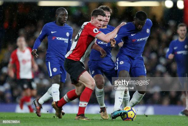 PierreEmile Hojbjerg of Southampton battles with Tiemoue Bakayoko of Chelsea during the Premier League match between Chelsea and Southampton at...