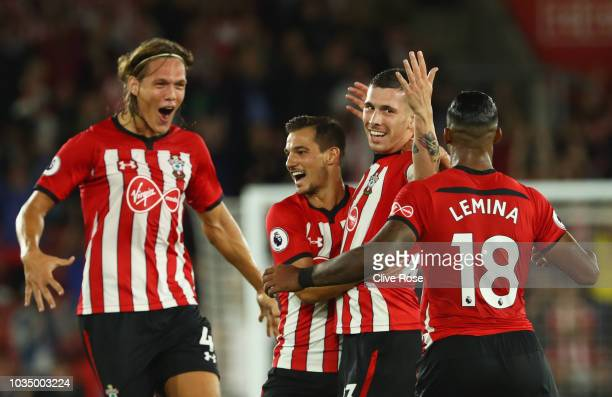 PierreEmile Hojbjerg of Southampton celebrates after scoring his team's first goal with team mates during the Premier League match between...