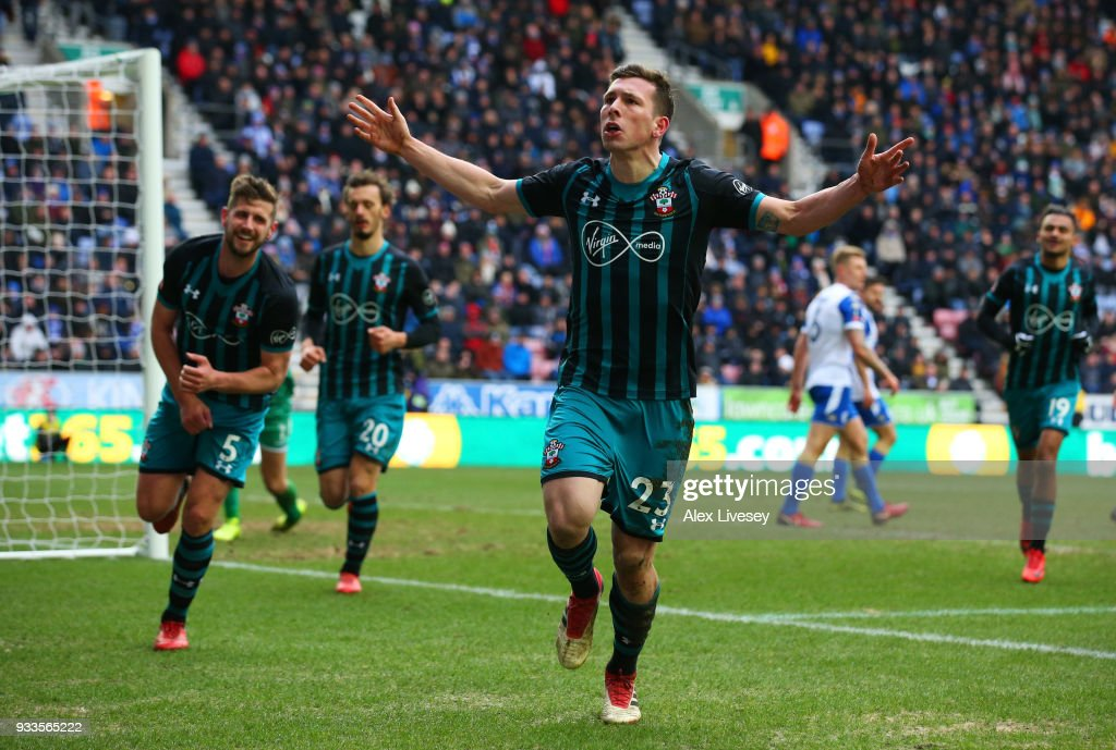 Pierre-Emile Hojbjerg of Southampton (23) celebrates as he scores their first goal during The Emirates FA Cup Quarter Final match between Wigan Athletic and Southampton at DW Stadium on March 18, 2018 in Wigan, England.