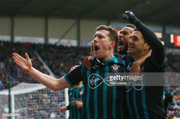 PierreEmile Hojbjerg of Southampton celebrates as he scores their first goal with Dusan Tadic and Ryan Bertrand during The Emirates FA Cup Quarter...