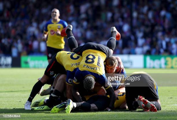 PierreEmile Hojbjerg of Southampton celebrates with teammates after scoring his team's second goal during the Premier League match between Crystal...
