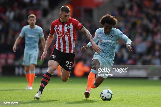 PierreEmile Hojbjerg of Southampton challenges Willian of Chelsea during the Premier League match between Southampton FC and Chelsea FC at St Mary's...