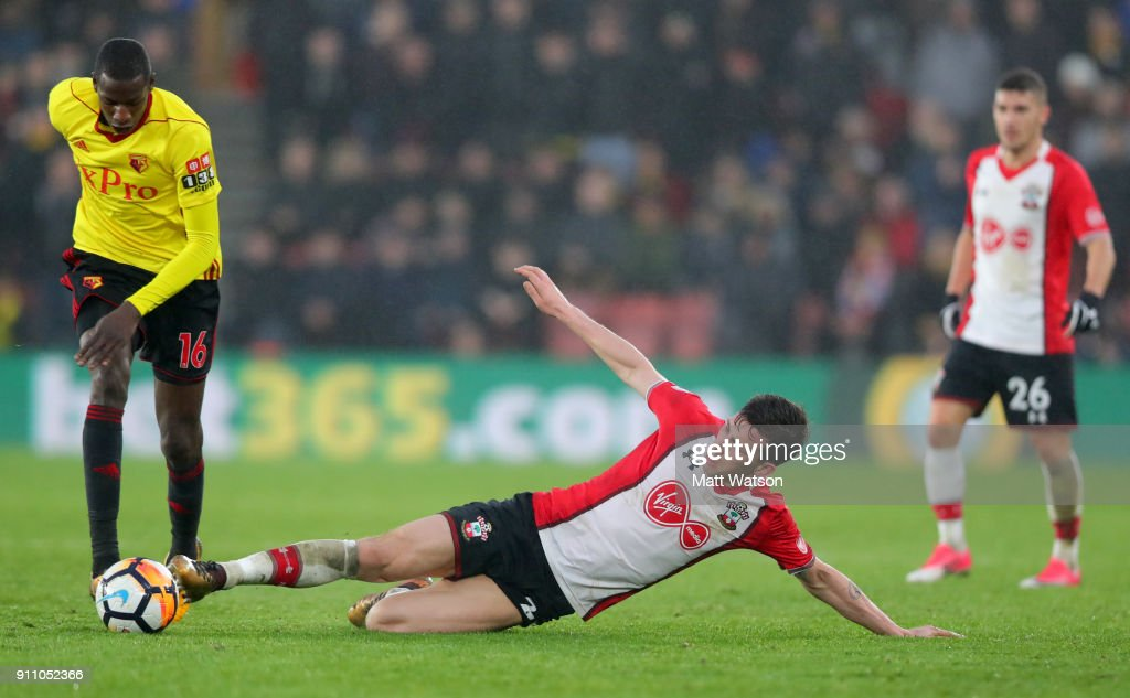 Pierre-Emile Hojbjerg(R) of Southampton FC gets a tackle in on Abdoulaye Doucoure of Watford during the FA Cup 4th round match between Southampton FC and Watford, at St Mary's Stadium on January 27, 2018 in Southampton, England.