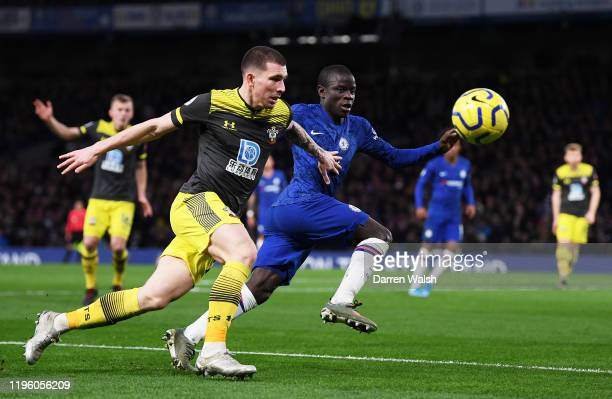 PierreEmile Hojbjerg of Southampton holds off N'Golo Kante of Chelsea during the Premier League match between Chelsea FC and Southampton FC at...