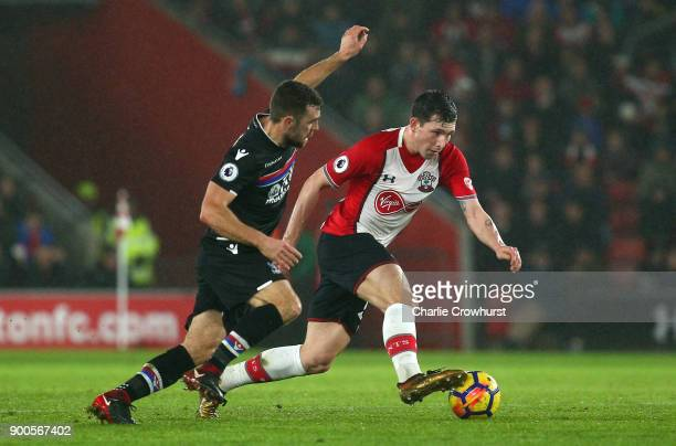PierreEmile Hojbjerg of Southampton is challenged by James McArthur of Crystal Palace during the Premier League match between Southampton and Crystal...