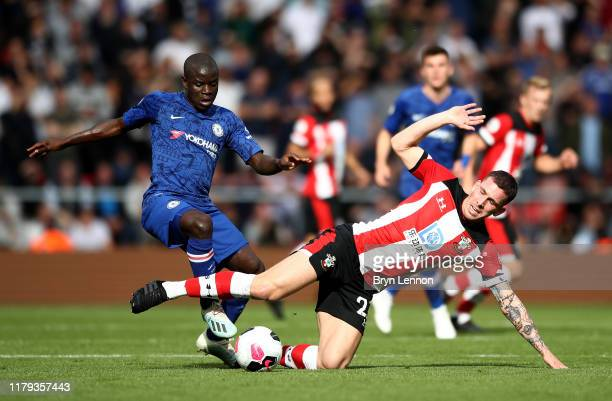 PierreEmile Hojbjerg of Southampton is challenged by N'Golo Kante of Chelsea during the Premier League match between Southampton FC and Chelsea FC at...