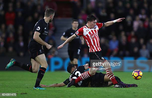 PierreEmile Hojbjerg of Southampton is fouled by Emre Can of Liverpool during the Premier League match between Southampton and Liverpool at St Mary's...