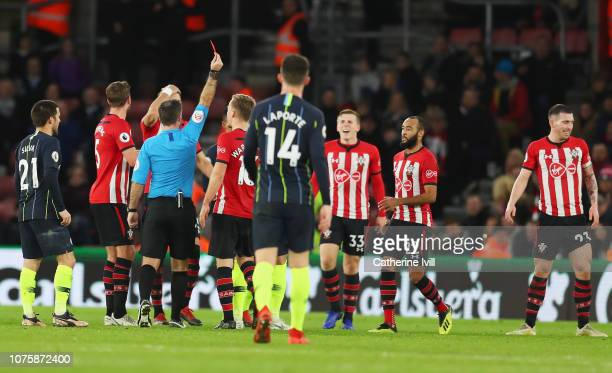 PierreEmile Hojbjerg of Southampton is shown a red card and is sent off by referee Paul Tierney during the Premier League match between Southampton...