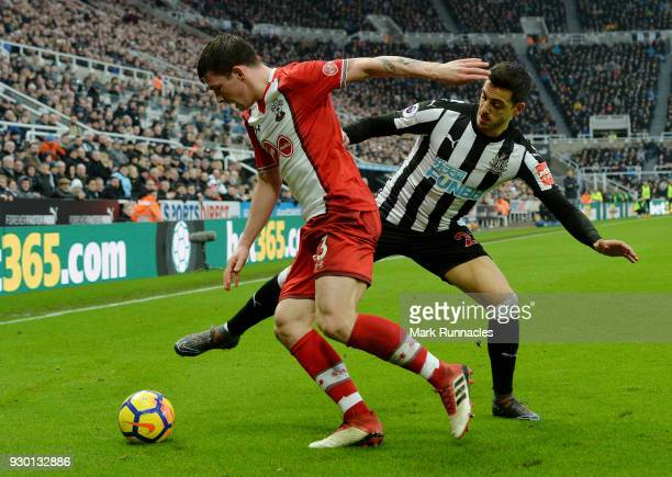 PierreEmile Hojbjerg of Southampton is tackled by Joselu of Newcastle United during the Premier League match between Newcastle United and Southampton...
